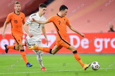 Netherlands' Steven Berghuis, right, and Bosnia and Herzegovina's Amir Hadziahmetovic vie for the ball during the UEFA Nations League soccer match between The Netherlands and Bosnia and Herzegovina at the Johan Cruyff ArenA in Amsterdam, Netherlands