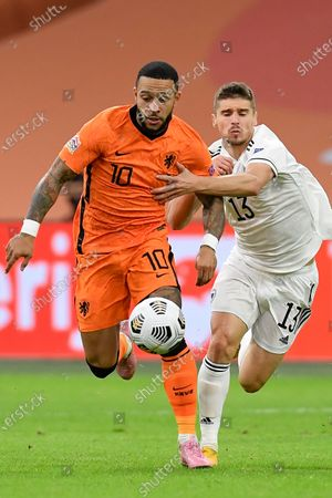 Netherlands' Memphis Depay, left, and Bosnia and Herzegovina's Gojko Cimirot vie for the ball during the UEFA Nations League soccer match between The Netherlands and Bosnia and Herzegovina at the Johan Cruyff ArenA in Amsterdam, Netherlands
