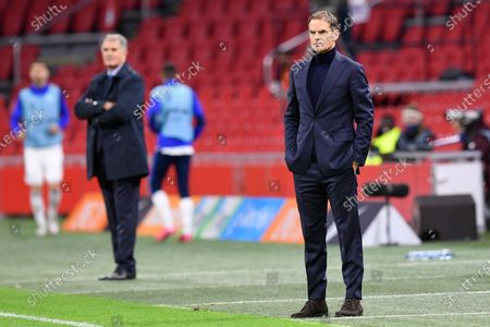 Netherlands' coach Frank de Boer, right, and Bosnia and Herzegovina's coach Dusan Bajevic, left, watch their teams play during the UEFA Nations League soccer match between The Netherlands and Bosnia and Herzegovina at the Johan Cruyff ArenA in Amsterdam, Netherlands