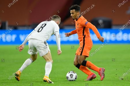 Netherlands' Owen Wijndal, right, and Bosnia and Herzegovina's Edin Visca vie for the ball during the UEFA Nations League soccer match between The Netherlands and Bosnia and Herzegovina at the Johan Cruyff ArenA in Amsterdam, Netherlands