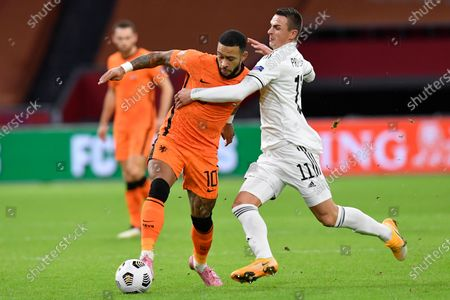 Netherlands' Memphis Depay, left, and Bosnia and Herzegovina's Miralem Pjanic vie for the ball during the UEFA Nations League soccer match between The Netherlands and Bosnia and Herzegovina at the Johan Cruyff ArenA in Amsterdam, Netherlands