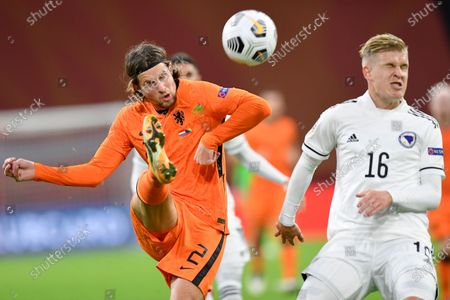 Netherlands' Hans Hateboer passes the ball before Bosnia and Herzegovina's Vladan Danilovic can get to it during the UEFA Nations League soccer match between The Netherlands and Bosnia and Herzegovina at the Johan Cruyff ArenA in Amsterdam, Netherlands