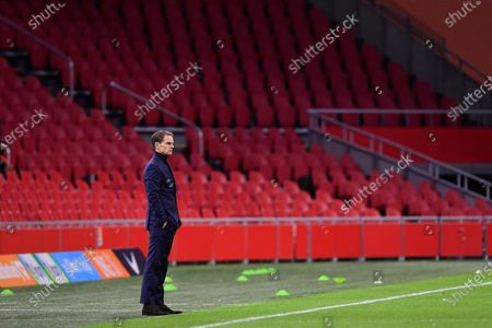 Netherlands' coach Frank de Boer watches his team as the empty stadium is seen during the UEFA Nations League soccer match between The Netherlands and Bosnia and Herzegovina at the Johan Cruyff ArenA in Amsterdam, Netherlands