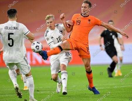 Netherlands' Luuk de Jong, right, and Bosnia and Herzegovina's Vladan Danilovic vie for the ball during the UEFA Nations League soccer match between The Netherlands and Bosnia and Herzegovina at the Johan Cruyff ArenA in Amsterdam, Netherlands