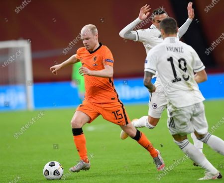 Netherlands' Davy Klaassen and Bosnia and Herzegovina's Rade Krunic, right, vie for the ball during the UEFA Nations League soccer match between The Netherlands and Bosnia and Herzegovina at the Johan Cruyff ArenA in Amsterdam, Netherlands