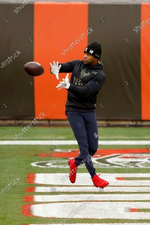 Houston Texans wide receiver Randall Cobb (18) warms up prior to the start of an NFL football game against the Cleveland Browns, in Cleveland