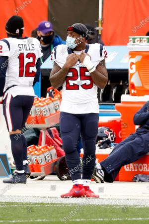 Houston Texans running back Duke Johnson (25) stands on the sideline during an NFL football game against the Cleveland Browns, in Cleveland