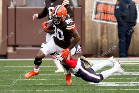 Houston Texans safety Eric Murray (23) tackles Cleveland Browns wide receiver Jarvis Landry (80) during an NFL football game, in Cleveland