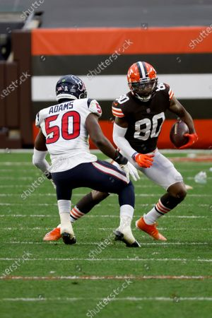 Stock Photo of Cleveland Browns wide receiver Jarvis Landry (80) attempts to run past Houston Texans linebacker Tyrell Adams (50) during an NFL football game, in Cleveland