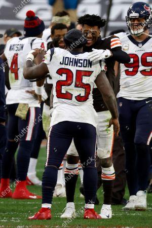 Cleveland Browns wide receiver Rashard Higgins (82) hugs Houston Texans running back Duke Johnson (25) after an NFL football game, in Cleveland