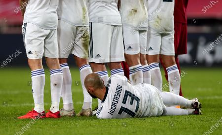 Russia's Fyodor Kudryashov lies on the pitch for a free kick during the UEFA Nations League soccer match between Turkey and Russia in Istanbul, Turkey, 15 November 2020.