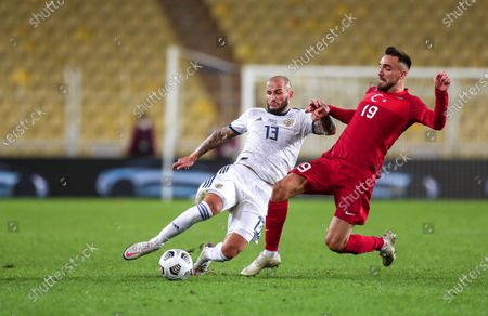 Stock Photo of Turkey's Emre Kilinc (R) in action against Russia's Fyodor Kudryashov (L) during the UEFA Nations League soccer match between Turkey and Russia in Istanbul, Turkey, 15 November 2020.