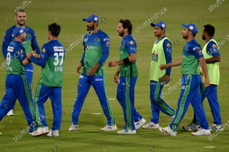 Stock Photo of Multan Sultans spinner Shahid Afridi, center, celebrates with teammates after taking the wicket of Lahore Qalandars batsman Mohammad Hafeez during the second eliminator cricket match of Pakistan Super League T20 cup at National Stadium in Karachi, Pakistan