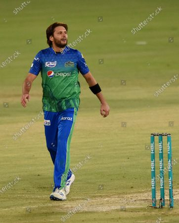 Multan Sultans spinner Shahid Afridi walks toward his bowling point during the second eliminator cricket match against Lahore Qalandars for Pakistan Super League T20 cup at National Stadium in Karachi, Pakistan