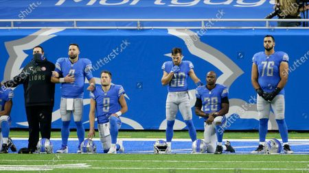 Detroit Lions head coach Matt Patricia, from left, Detroit Lions quarterback Chase Daniel (4), Detroit Lions quarterback Matthew Stafford (9), Detroit Lions wide receiver Danny Amendola (80), Detroit Lions running back Adrian Peterson (28), Detroit Lions offensive guard Oday Aboushi (76) are shown during the national anthem before an NFL football game against the Washington Football Team, in Detroit
