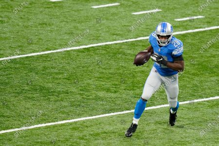 Detroit Lions running back Adrian Peterson (28) rushes during the first half of an NFL football game against the Washington Football Team, in Detroit