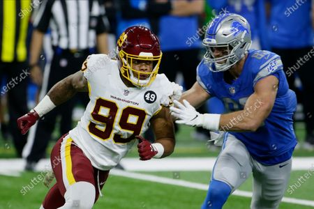 Washington Football Team defensive end Chase Young (99) rushes against Detroit Lions tight end Jesse James (83) during the first half of an NFL football game, in Detroit