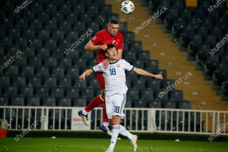 Turkey's Merih Demiral, top and Russia's Yuri Zhirkov, jump for the ball during the UEFA Nations League soccer match between Turkey and Russia in Istanbul