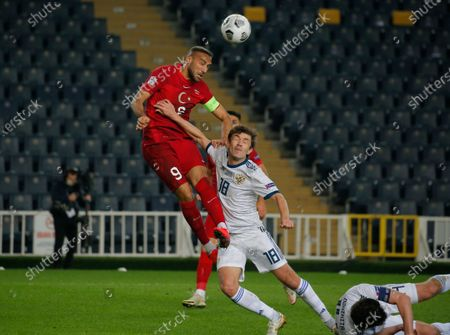 Turkeys captain Cenk Tosun, left, fights for the ball with Russia Yuri Zhirkov during the UEFA Nations League soccer match between Turkey and Russia in Istanbul