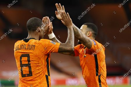 Georginio Wijnaldum (L) of the Netherlands celebrates with teammate Memphis Depay (R) after scoring the 2-0 lead during the UEFA Nations League soccer match between the Netherlands and Bosnia and Herzegovina at Johan Cruyff Arena in Amsterdam, Netherlands, 15 November 2020.