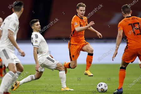 Stock Image of Gojko Cimirot (C-L) of Bosnia in action against Frenkie de Jong (C-R) of the Netherlands during the UEFA Nations League soccer match between the Netherlands and Bosnia and Herzegovina at Johan Cruyff Arena in Amsterdam, Netherlands, 15 November 2020.