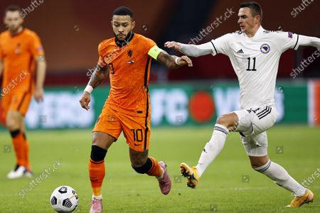 Stock Photo of Memphis Depay (L) of the Netherlands in action against Smail Prevljak (R) of Bosnia during the UEFA Nations League soccer match between the Netherlands and Bosnia and Herzegovina at Johan Cruyff Arena in Amsterdam, Netherlands, 15 November 2020.