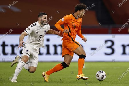 Stock Picture of Sead Kolasinac (L) of Bosnia in action against Calvin Stengs (R) of the Netherlands during the UEFA Nations League soccer match between the Netherlands and Bosnia and Herzegovina at Johan Cruyff Arena in Amsterdam, Netherlands, 15 November 2020.