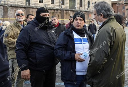 Stock Picture of Leaders of Forza Nuova ultra right movement Giuliano Castellino (L) and Roberto Fiore (R) during the demonstration by Orange Jackets and Forza Nuova ultra right movement in Rome, Italy, 15 November 2020. The demonstration is organised to protest against the decisions of the Italian Government on the pandemic of Covid-19.