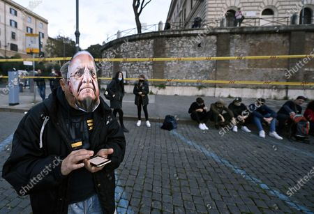 A protester with a mask of Vincenzo De Luca, president of Campania Region, during the demonstration by Orange Jackets and Forza Nuova ultra right movement in Rome, Italy, 15 November 2020. The demonstration is organised to protest against the decisions of the Italian Government on the pandemic of Covid-19.