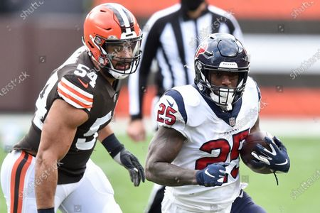 Houston Texans running back Duke Johnson (25) rushes as Cleveland Browns defensive end Olivier Vernon (54) pursues during the first half of an NFL football game, in Cleveland