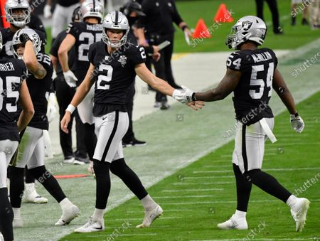 Las Vegas Raiders kicker Daniel Carlson #2 celebrates on the sidelines with middle linebacker Raekwon McMillan #54 during the first half against the Denver Broncos during an NFL football game, in Las Vegas