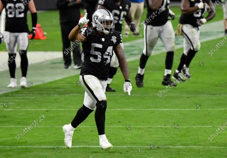 Las Vegas Raiders middle linebacker Raekwon McMillan #54 celebrates on the sidelines after an interception by defensive end Carl Nassib #94 during the second half against the Denver Broncos during an NFL football game, in Las Vegas
