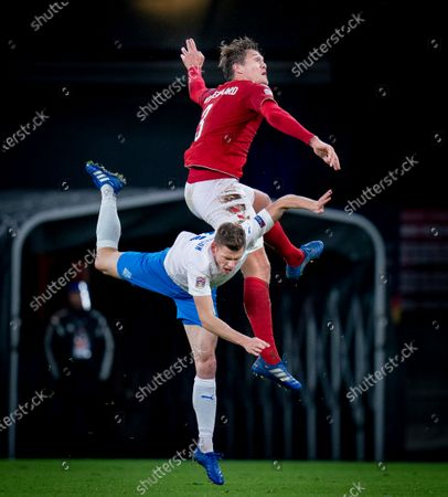 Stock Picture of Denmarks Jannik Vestergaard, top, and Icelands Alfred Finnbogason during the UEFA Nations League - League A - Group 2 Match between Denmark and Iceland, in Copenhagen, Denmark, 15 November 2020.