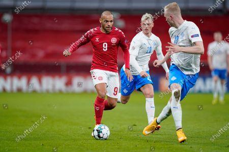 Denmarks Martin Braithwaite, left, and Icelands Albert Gudmundsson, center, and Hordur Bjorvin Magnusson, right, during the UEFA Nations League - League A - Group 2 Match between Denmark and Iceland, in Copenhagen, Denmark, 15 November 2020.