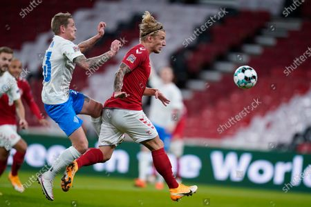 Denmarks Simon Kjaer, left, and Icelands Ari Skulason, left, during the UEFA Nations League - League A - Group 2 Match between Denmark and Iceland, in Copenhagen, Denmark, 15 November 2020.