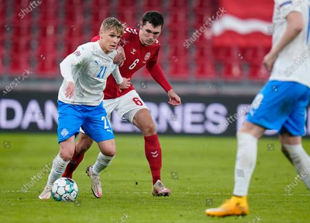 Denmarks Andreas Christensen, center, and Icelands Arnor Sigurdsson, left, during the UEFA Nations League - League A - Group 2 Match between Denmark and Iceland, in Copenhagen, Denmark, 15 November 2020.