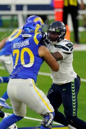 Seattle Seahawks defensive end Carlos Dunlap, right, is defended by Los Angeles Rams offensive guard Joe Noteboom (70) during the second half of an NFL football game, in Inglewood, Calif