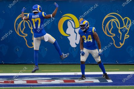 Los Angeles Rams running back Malcolm Brown (34), right, celebrates his touchdown with Los Angeles Rams wide receiver Robert Woods (17) during an NFL football game, in Inglewood, Calif