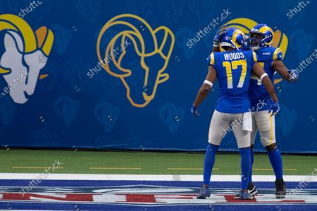 Los Angeles Rams running back Malcolm Brown (34), right, celebrates his touchdown with wide receiver Robert Woods (17) during an NFL football game against the Seattle Seahawks, in Inglewood, Calif