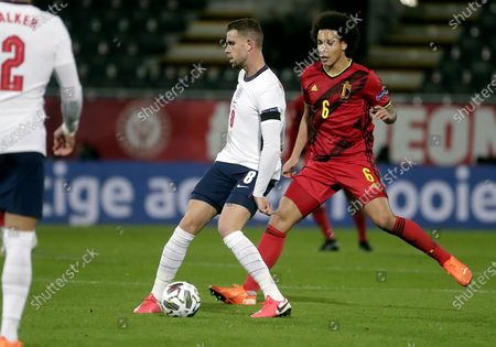 Jordan Henderson of England and Axel Witsel of Belgium (R) in action during the UEFA Nations League soccer match between Belgium and England in Leuven, Belgium, 15 November 2020.