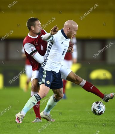 Stefan Ilsanker of Austria (L) and Liam Boyce of Northern Ireland (R) in action during the UEFA Nations League League group B1 soccer match between Austria and Northern Ireland in Vienna, Austria, 15 November 2020.