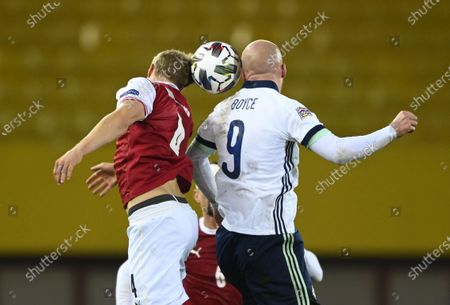 Martin Hinteregger of Austria (L) and Liam Boyce of Northern Ireland (R) in action during the UEFA Nations League League group B1 soccer match between Austria and Northern Ireland in Vienna, Austria, 15 November 2020.