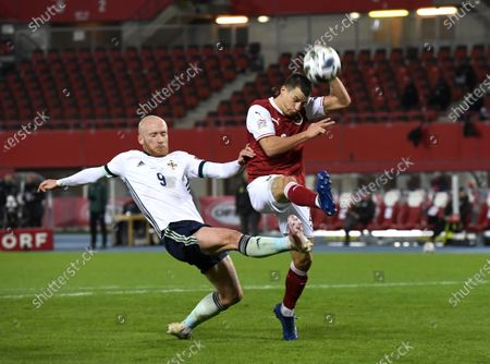 Liam Boyce of Northern Ireland (L) and Stefan Lainer of Austria (R) in action during the UEFA Nations League League group B1 soccer match between Austria and Northern Ireland in Vienna, Austria, 15 November 2020.