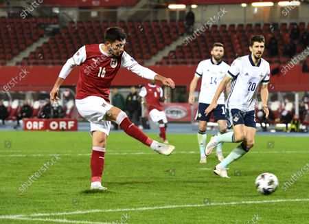 Adrian Grbic of Austria (L) and Craig Cathcart of Northern Ireland (R) in action during the UEFA Nations League League group B1 soccer match between Austria and Northern Ireland in Vienna, Austria, 15 November 2020.