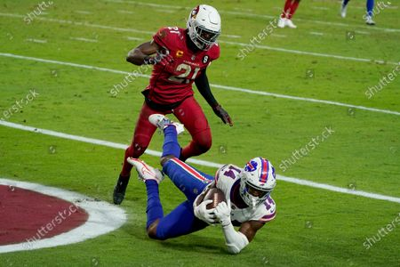 Buffalo Bills wide receiver Stefon Diggs (14) pulls in a touchdown pass as Arizona Cardinals cornerback Patrick Peterson (21) defends during the second half of an NFL football game, in Glendale, Ariz