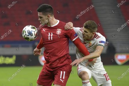 Luka Jovic (L) of Serbia in action against David Siger (R) of Hungary during the UEFA Nations League soccer match between Hungary and Serbia at Puskas Arena in Budapest, Hungary, 15 November 2020.
