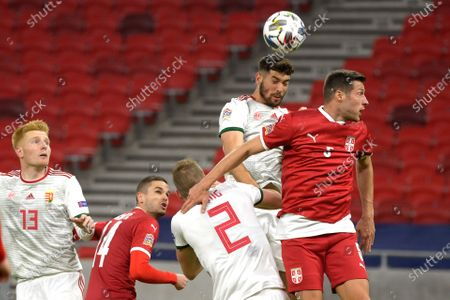 Barnabas Bese (2-R) of Hungary in action against Uros Spajic (R) of Serbia during the UEFA Nations League soccer match between Hungary and Serbia at Puskas Arena in Budapest, Hungary, 15 November 2020.