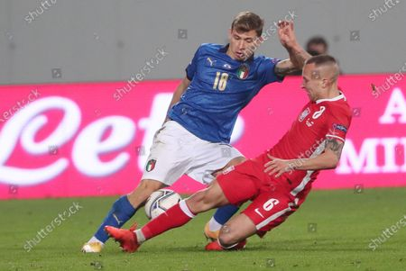 Italy's Nicolo Barella (L) and Poland's Jacek Goralski (R) in action during the UEFA Nations League soccer match between Italy and Poland at Mapei Stadium in Reggio Emilia, Italy, 15 November 2020.