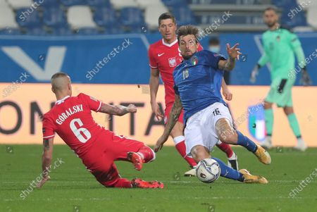 Italy's Francesco Acerbi (R) and Poland's Jacek Goralski  (L) in action during the UEFA Nations League soccer match between Italy and Poland at Mapei Stadium in Reggio Emilia, Italy, 15 November 2020.