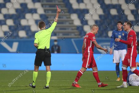 Stock Photo of Referee Clement Turpin shows the red card to Poland's Jacek Goralski (C) during the UEFA Nations League soccer match between Italy and Poland at Mapei Stadium in Reggio Emilia, Italy, 15 November 2020.